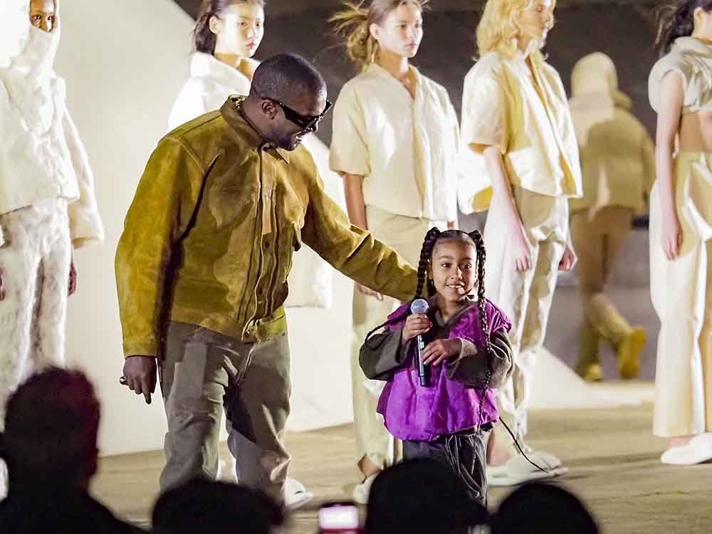 """Kanye West and daughter North West attends the """"Yeezy Season 8"""" show as part of the Paris Fashion Week Womenswear Fall/Winter 2020/2021 on March 02, 2020 in Paris, France. I Image: Getty Images."""