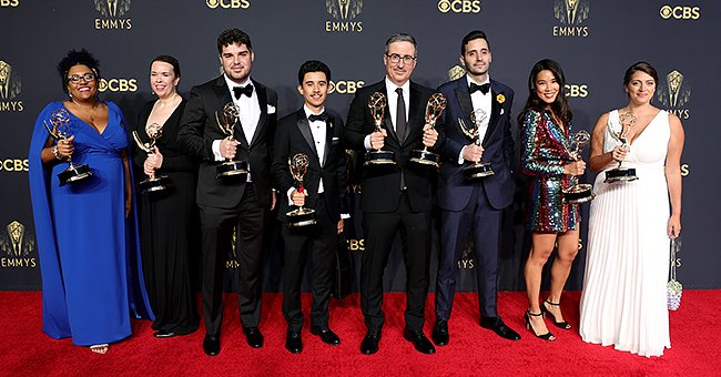 John Oliver poses in the press room with fellow writers during the 73rd Primetime Emmy Awards, September 2021 | Source: Getty Images