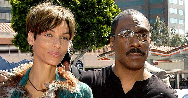 Eddie Murphy's Ex-wife Nicole Flaunts Her Stunning Physique in a White Bodysuit with Feathered Sleeve