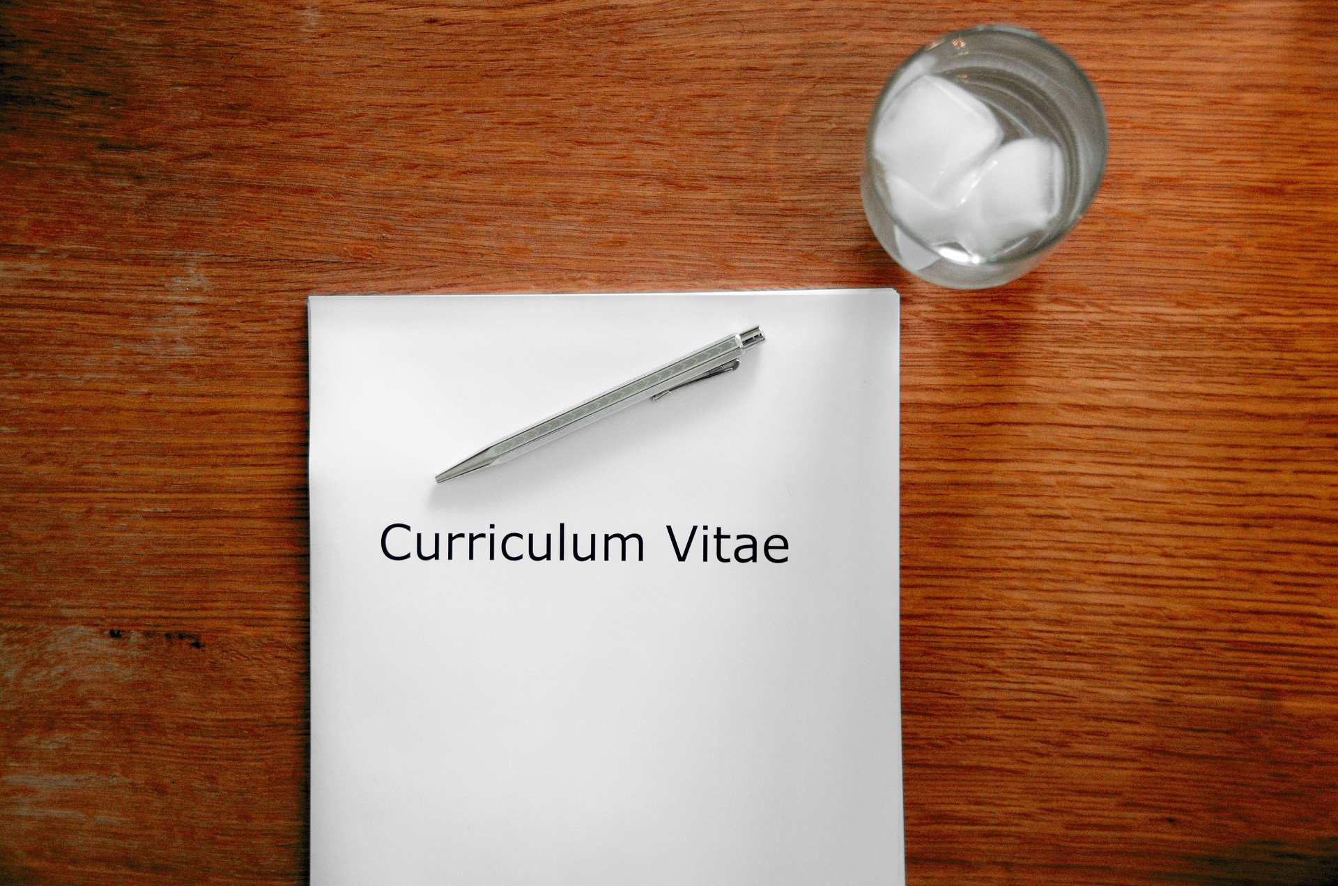 Pictured - A Curriculum Vitae on top a desk during a interview | Source: Pixabay