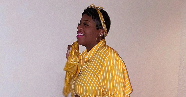 Pregnant Fantasia Cradles Her Belly Posing in Striped Yellow Outfit & Pink Feathered High Heels