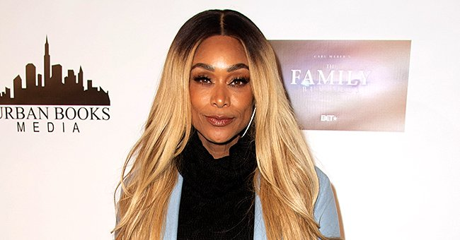 Tami Roman Shows off Fit Figure Posing with Bill Bellamy in a Cute Throwback Photo