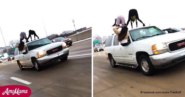 Two young women filmed twerking on top of a moving car in rush hour traffic