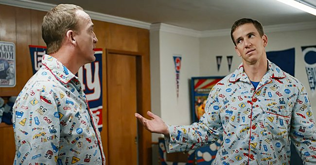 Eli and Peyton Manning in matching pajamas for a Super Bowl commercial, 2021. | Photo: youtube.com/OfficialFritoLay