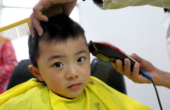 A boy gets a haircut at the saloon   Photo: Getty Images