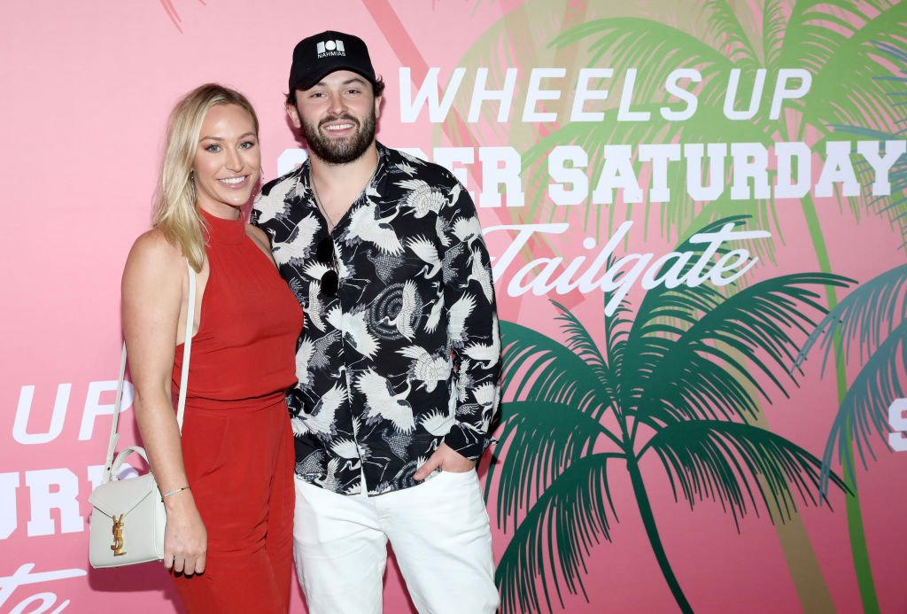 Emily Wilkinson and Baker Mayfield at Wheels Up members-only Super Saturday Tailgate event on February 1, 2020 | Photo: Getty Images