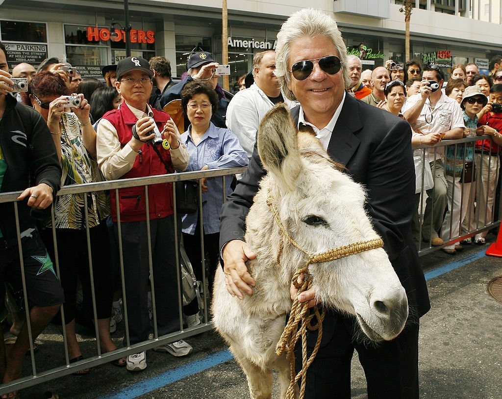 Producer John Peters poses with a burro at the ceremony honoring him with a star on the Hollywood Walk of Fame May 1, 2007. | Photo: Getty Images