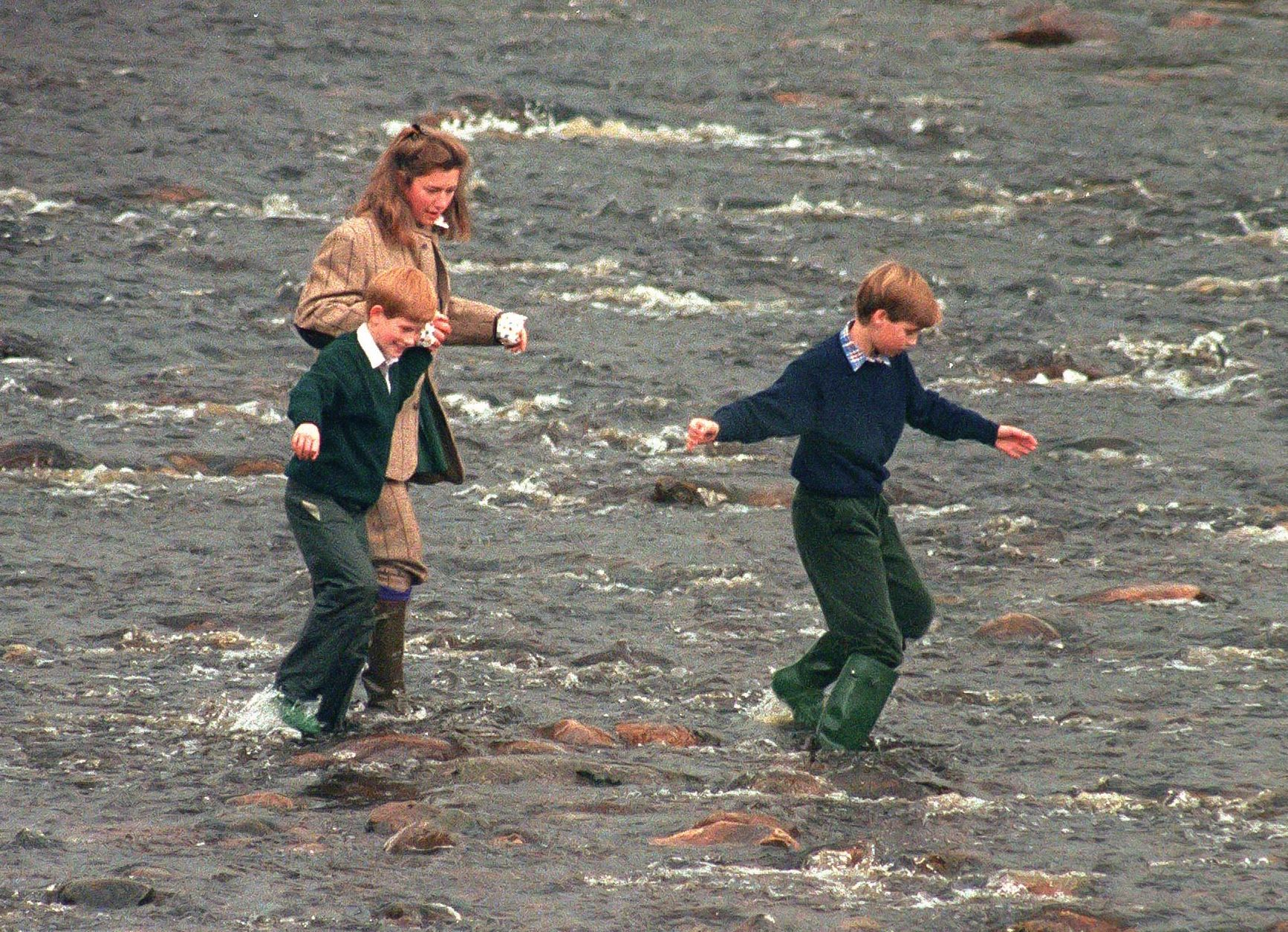 Royal Nanny, Tiggy Legge-Bourke, Prince William,and Prince Harry walk in the River Gairn, near the Balmoral Estate on October 22, 1994 in Balmoral, Scotland   Getty Images