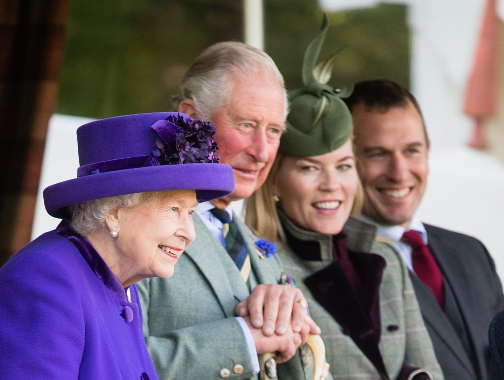 Queen Elizabeth , Prince Charles, Autumn Phillips and Peter Phillips sit front row at the 2019 Braemar Highland Games on September 07, 2019. | Photo: Getty Images