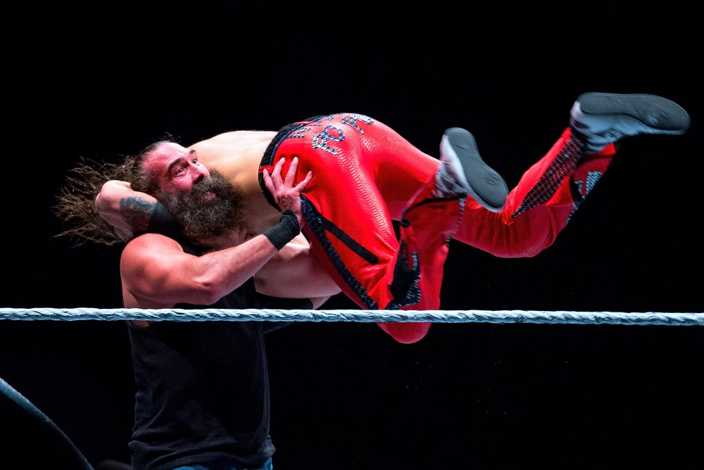 Luke Harper wrestling Nakamura at WWE Live at the Palau Sant Jordi on November 4, 2017, in Barcelona, Spain | Photo: Shutterstock/Christian Bertrand