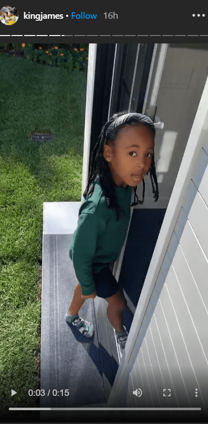 A picture of Zhuri James standing in front of her new playhouse. | Photo: Instagram/Kingjames