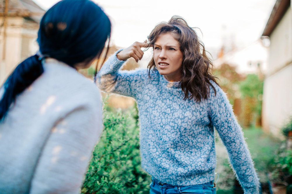 Two women screaming at each other during an argument | Photo: Shutterstock/Aloha Hawaii