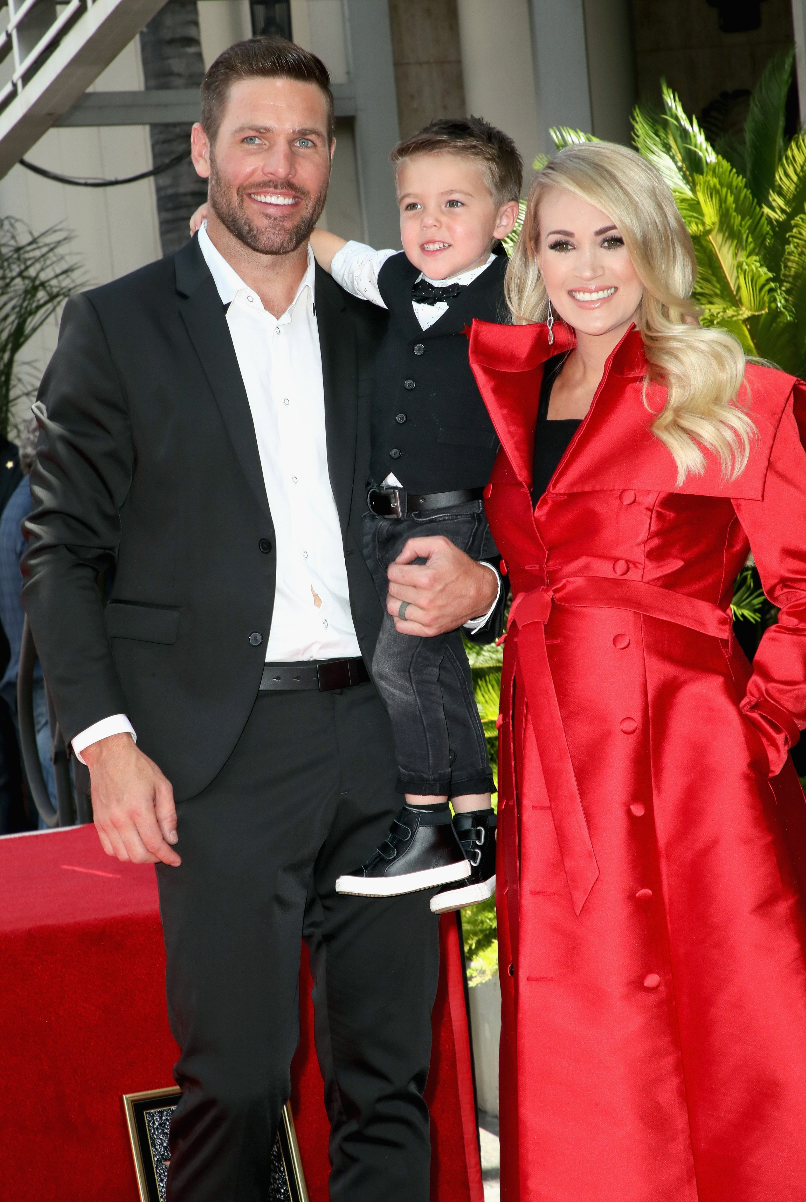 Mike Fisher, Carrie Underwood, and son Isaiah Michael Fisher at Underwood's Hollywood Walk of Fame ceremony in Los Angeles | Photo: Getty Images
