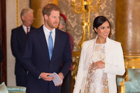 Meghan, Duchess of Sussex and Prince Harry, Duke of Sussex attend a reception to mark the fiftieth anniversary of the investiture of the Prince of Wales at Buckingham Palace | Photo: Getty Images