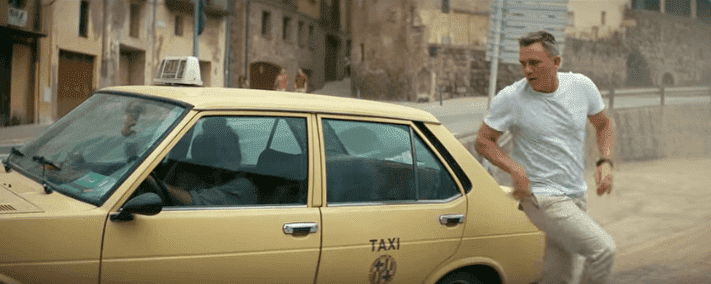 Daniel Craig getting out of a taxi in the new advert for Heineken released on January 14, 2020. | Source: YouTube/Heineken