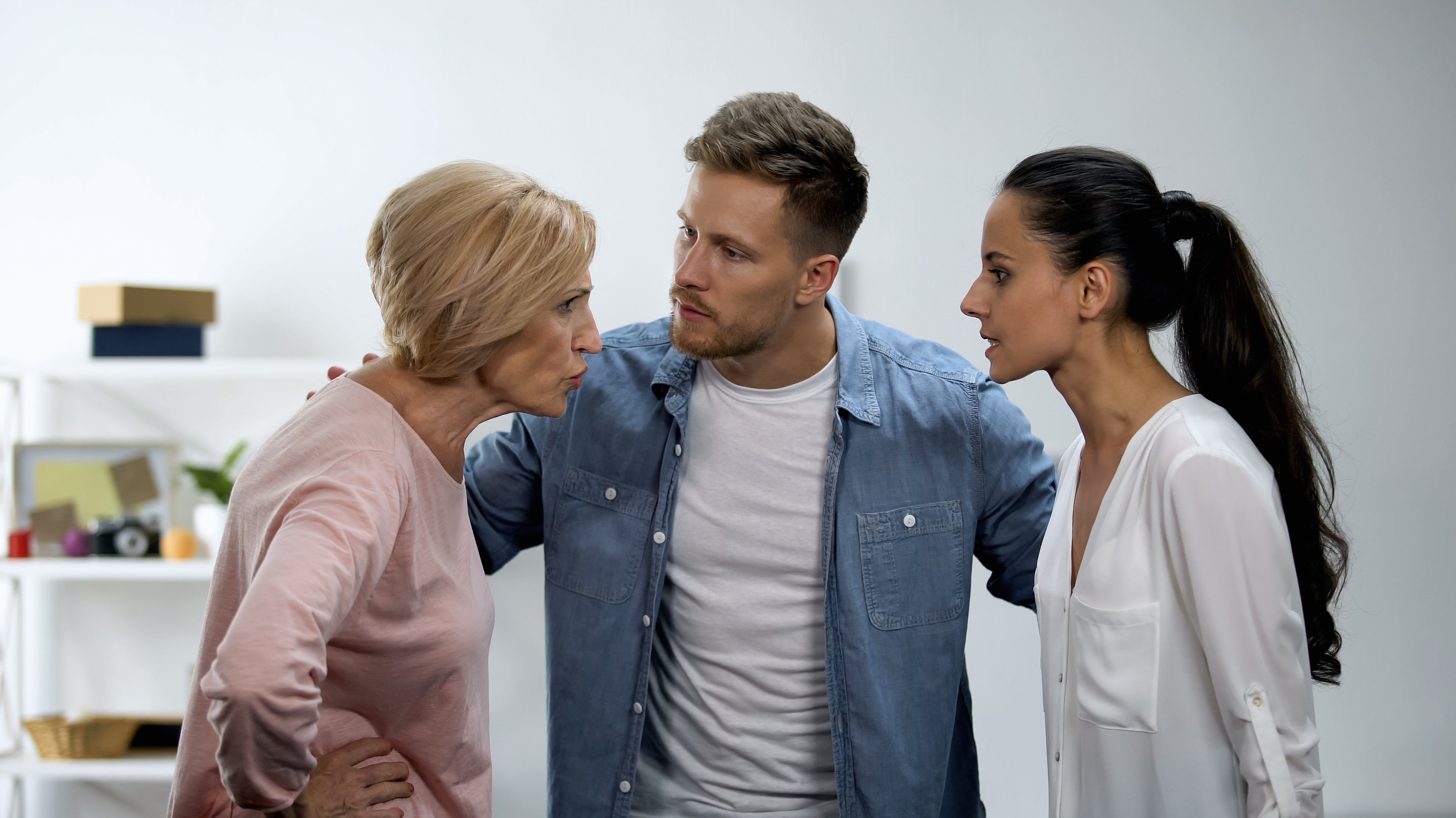 A man trying to stop a fight between his mother and his wife   Photo: Shutterstock