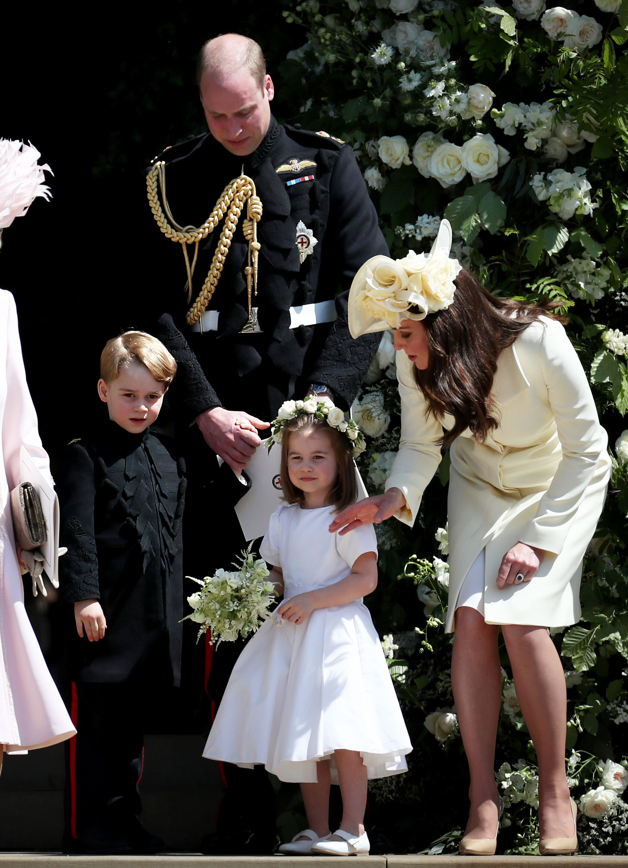 Prince William, Kate Middleton, Prince George and Princess Charlotte after the wedding of Prince Harry and Ms. Meghan Markle at St George's Chapel at Windsor Castle on May 19, 2018 in Windsor, England | Photo: Getty Images