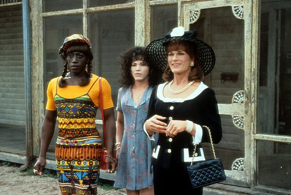 """Wesley Snipes, John Leguizamo, and Patrick Swayze stand outside a run down building in a scene from the film """"To Wong Foo Thanks for Everything, Julie Newmar,"""" in 1995. 