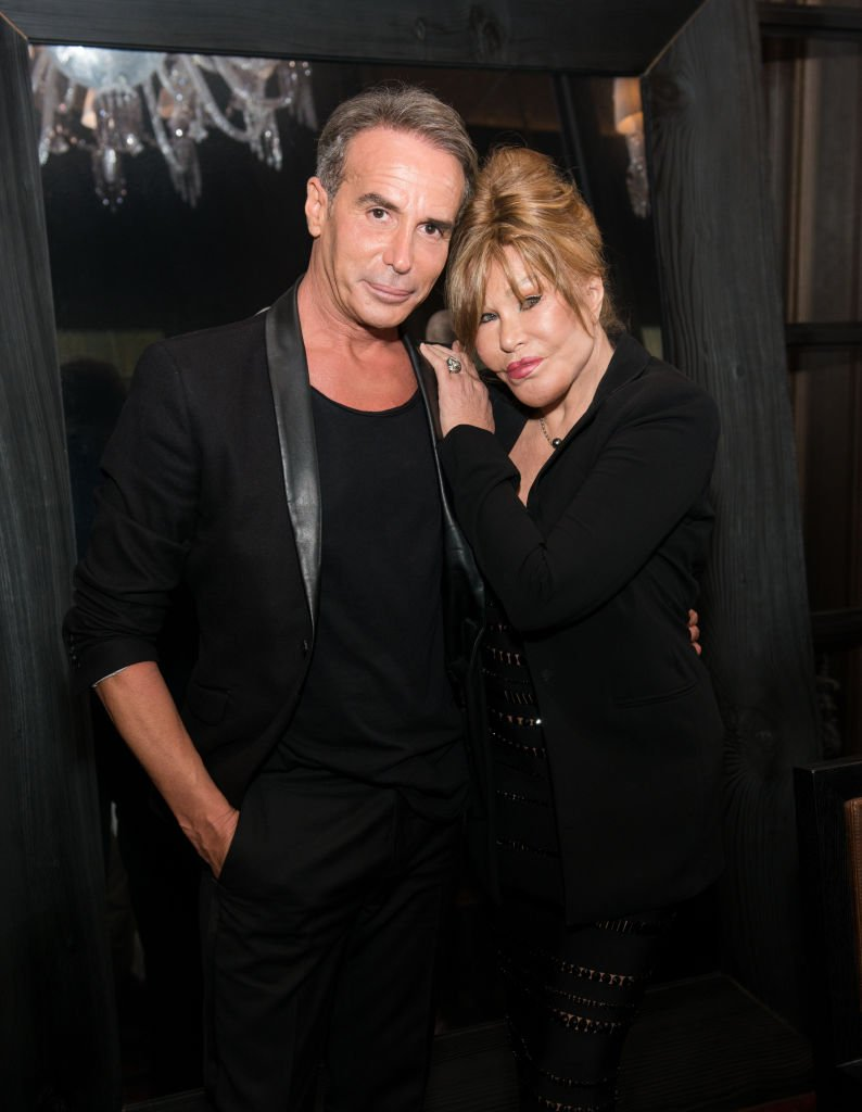 Lloyd Klein and Jocelyn Wildenstein pose for a photo at Baccarat Hotel on August 5, 2017 in New York City. | Source: Getty Images