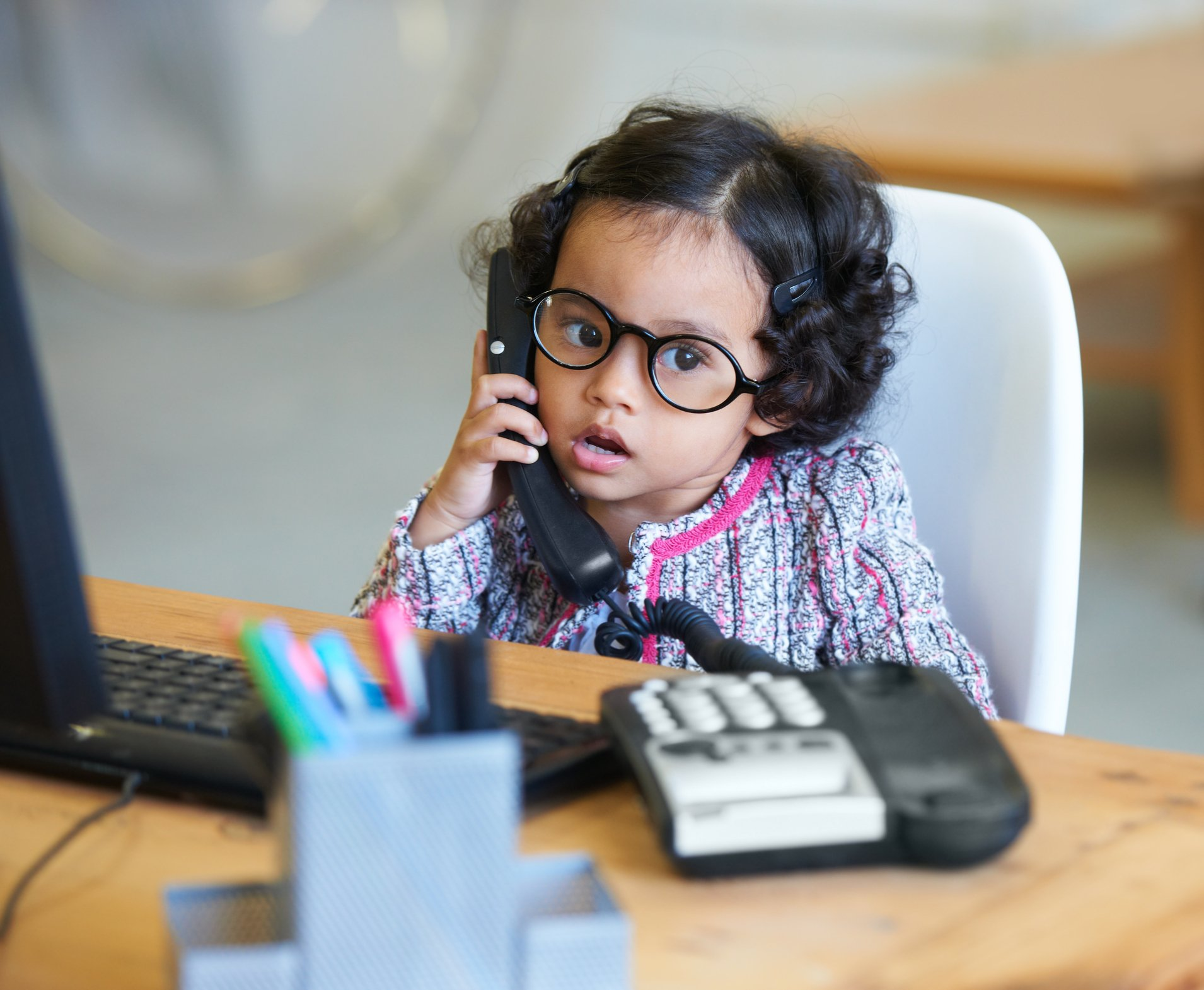 A cute little girl talking on the telephone. | Photo: Getty Images