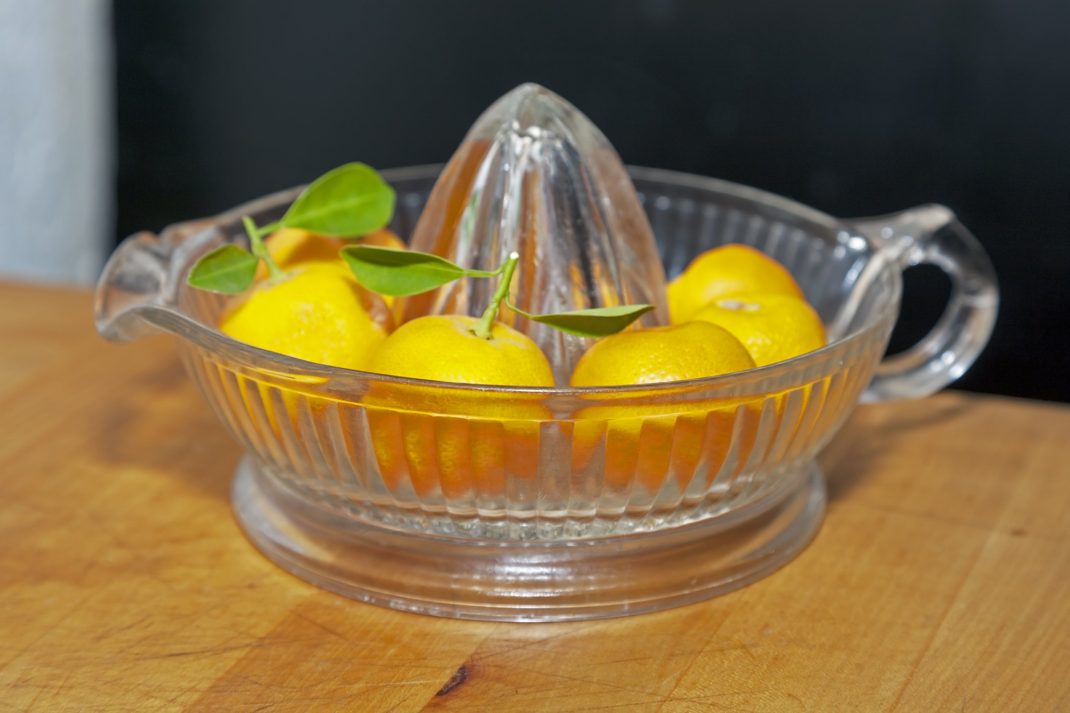 Photo of Calamondin oranges arranged in vintage juicer | Getty Images