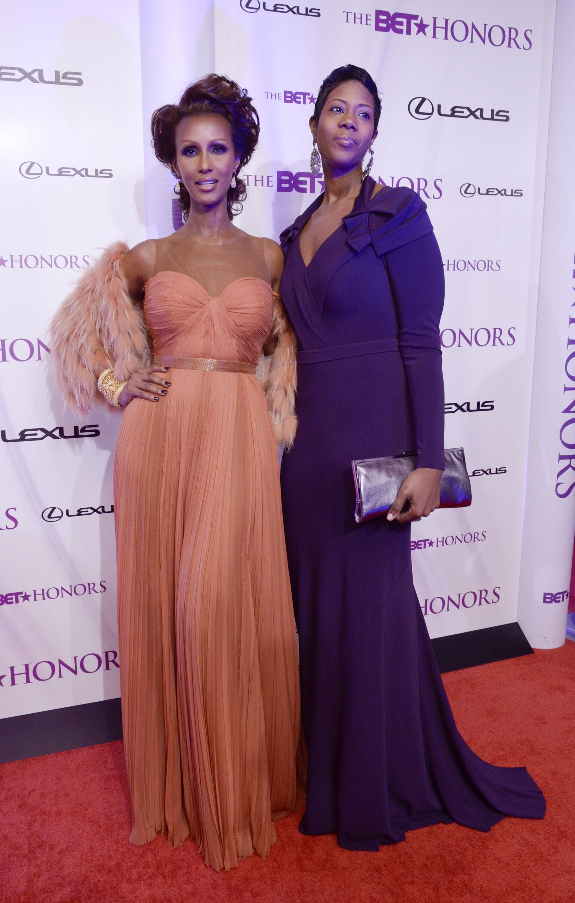 Iman and Zulekha Haywood pose for photographers on the red carpet during the 4th annual BET Honors at the Warner Theatre on January 15, 2011. | Source: Getty Images