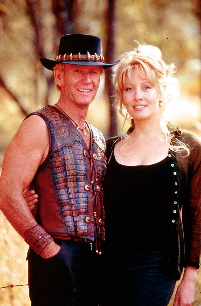 "Paul Hogan and Linda Koslowski pose for a photo on the set of ""Crocodile Dundee in Los Angeles."" 