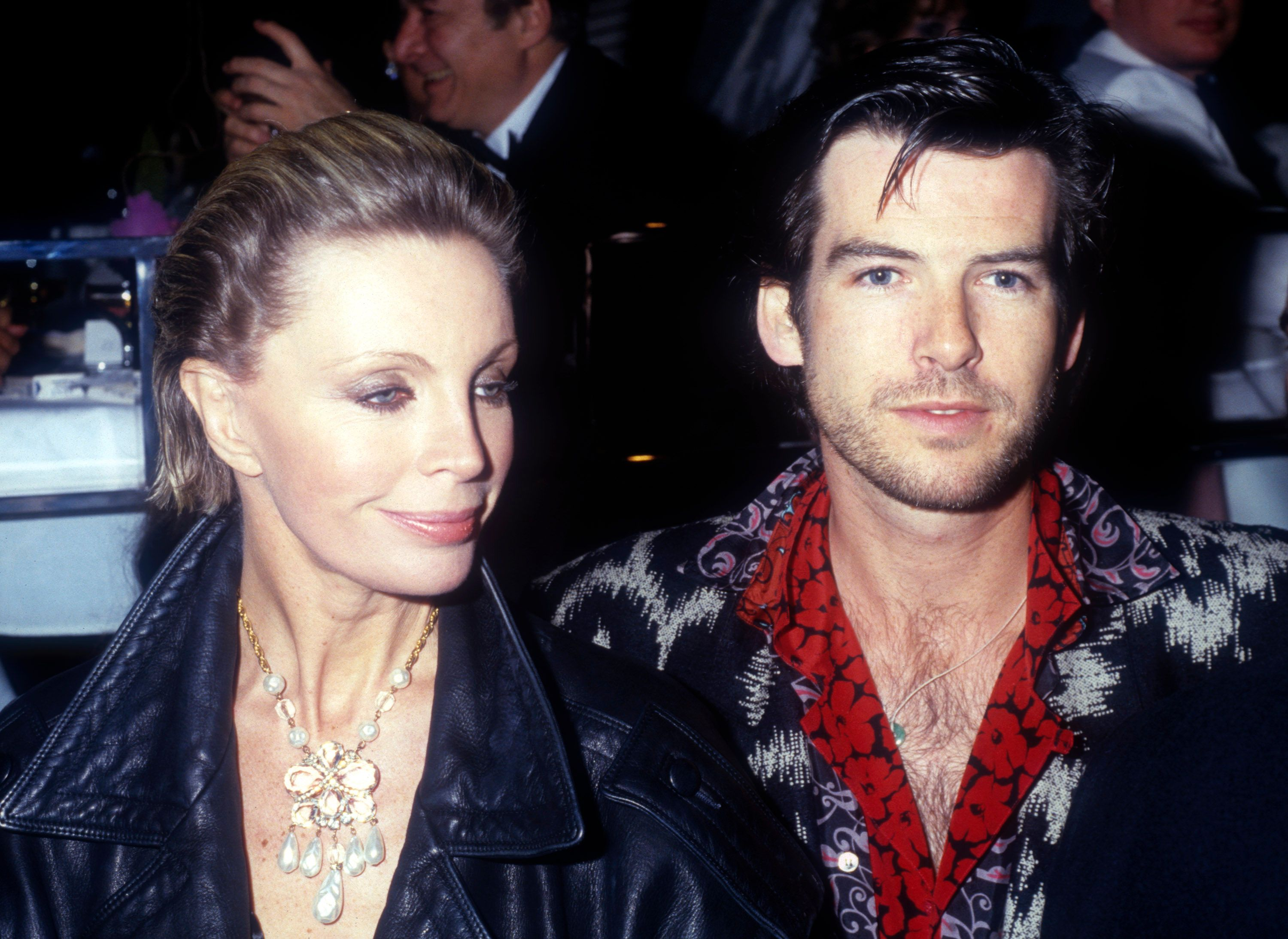 Pierce Brosnan and his now-late wife Cassandra Harris at the opening night party at Stringfellow's in 1986 in New York City | Source: Getty Images