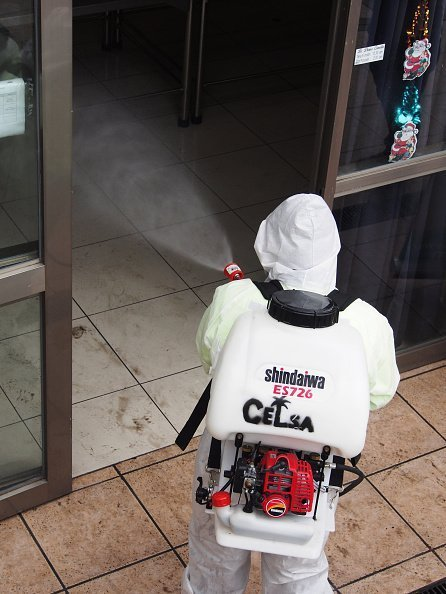 A man pictured fumigating a building | Photo: Getty Images