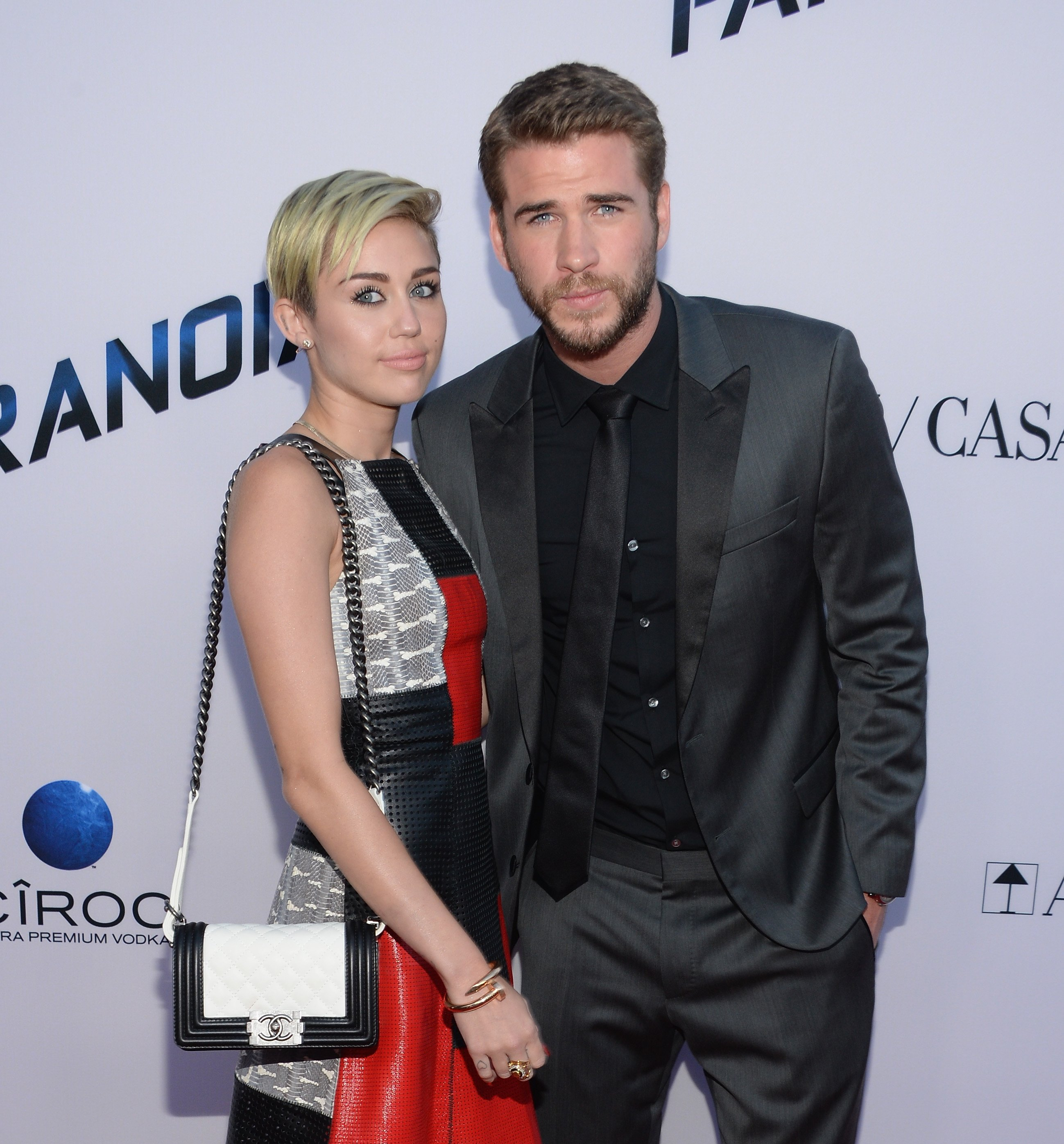 "Miley Cyrus and Liam Hemsworth attend the premiere of Relativity Media's ""Paranoia"" at DGA Theater on August 8, 2013. 