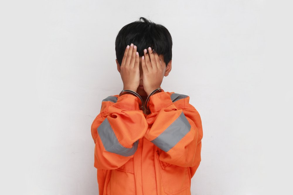 Young boy arrested | Shutterstock