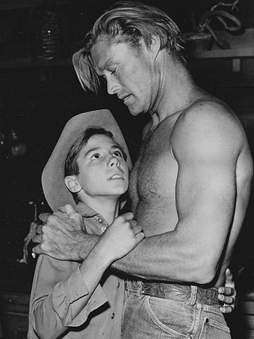 "Johnny Crawford and Chuck Connors in ""The Rifleman"" in 1961. 