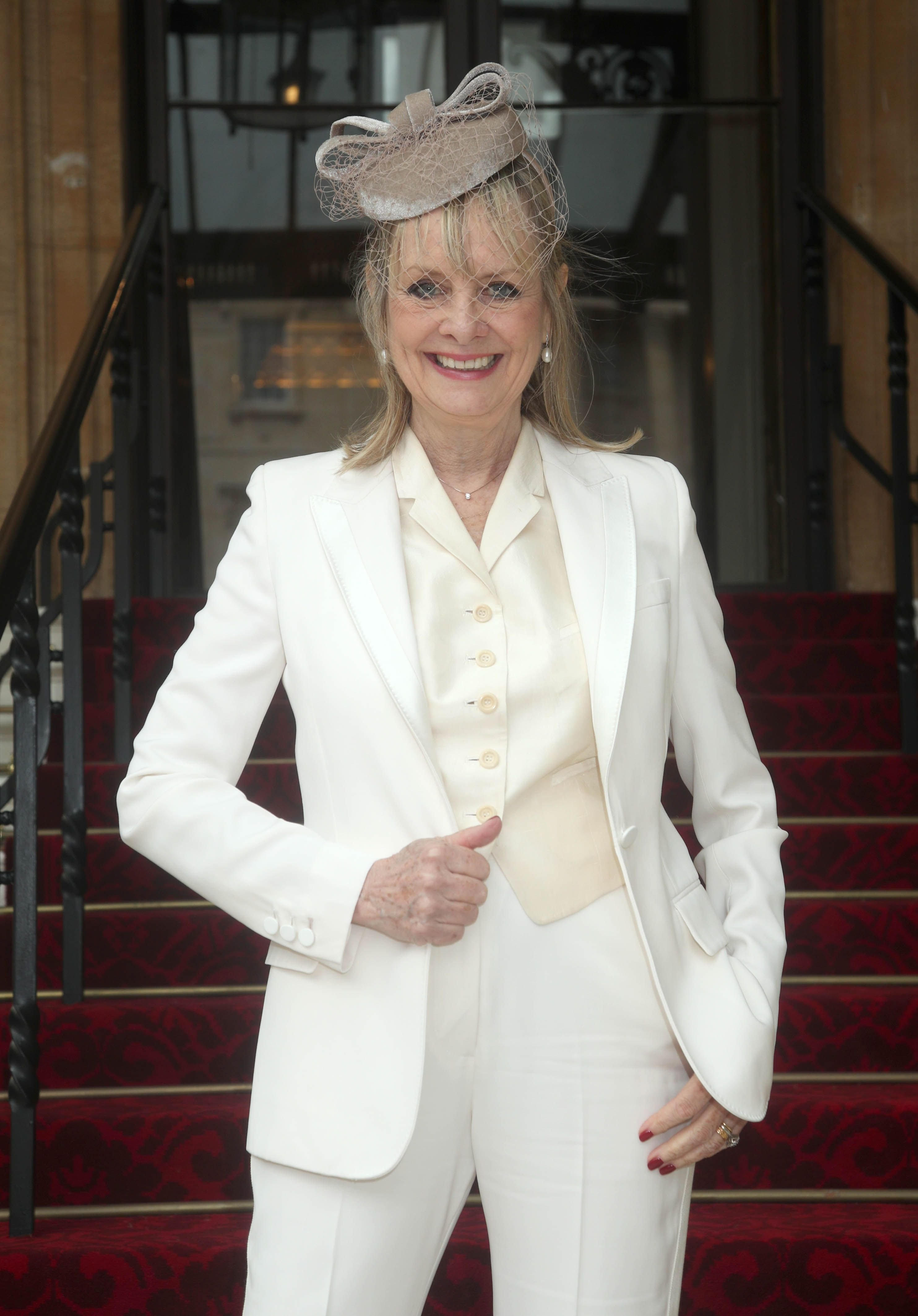 """Lesley """"Twiggy"""" Lawson arrives at Buckingham Palace where she will be made a Dame Commander of the Order of the British Empire for services to fashion, the arts and charity, during an Investiture ceremony conducted by the Prince of Wales on March 14, 2019 in London, England.   Source: Getty Images"""