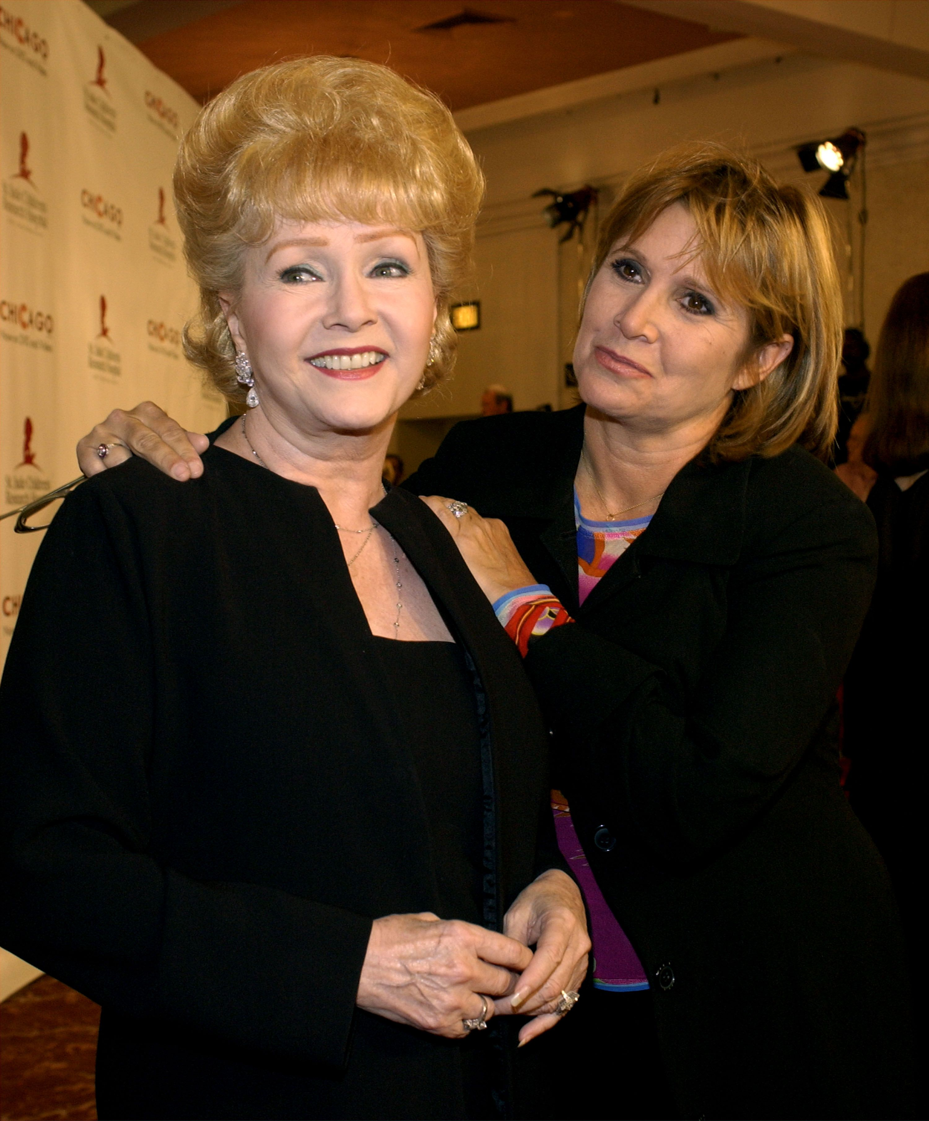 """Debbie Reynolds and Carrie Fisher at the 2nd Annual """"Runway for Life"""" celebrity fashion show at the Beverly Hilton August 19, 2003 