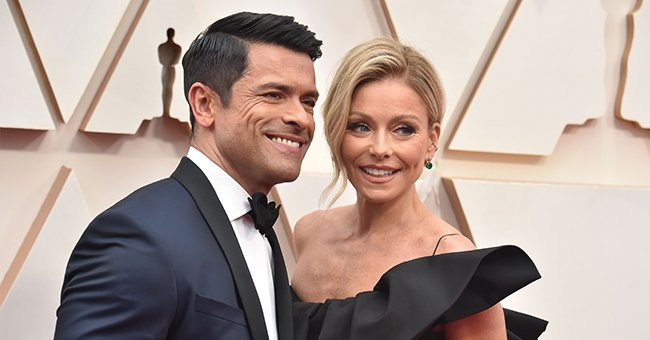 Kelly Ripa Teases Fans Showing a Seductive Photo of Husband Mark Consuelos Printed on a Pillow