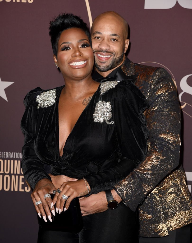 """Fantasia Barrino and her husband Kendall Taylor share an embrace as they arrived at the """"Q85: A Musical Celebration for Quincy Jones"""" on September 25, 2018, in Los Angeles, California 