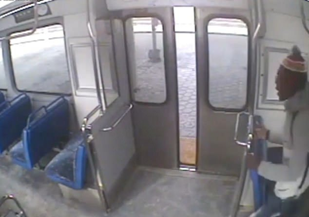 CCTV Footage - Passenger sees father outside / Source: YouTube/ Associated Press
