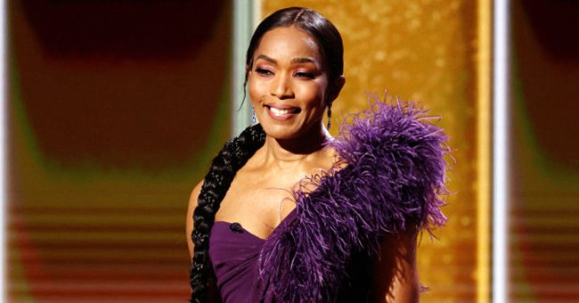 Angela Bassett Dazzles at the Golden Globes in a Figure-Hugging Purple Dress with Feathers