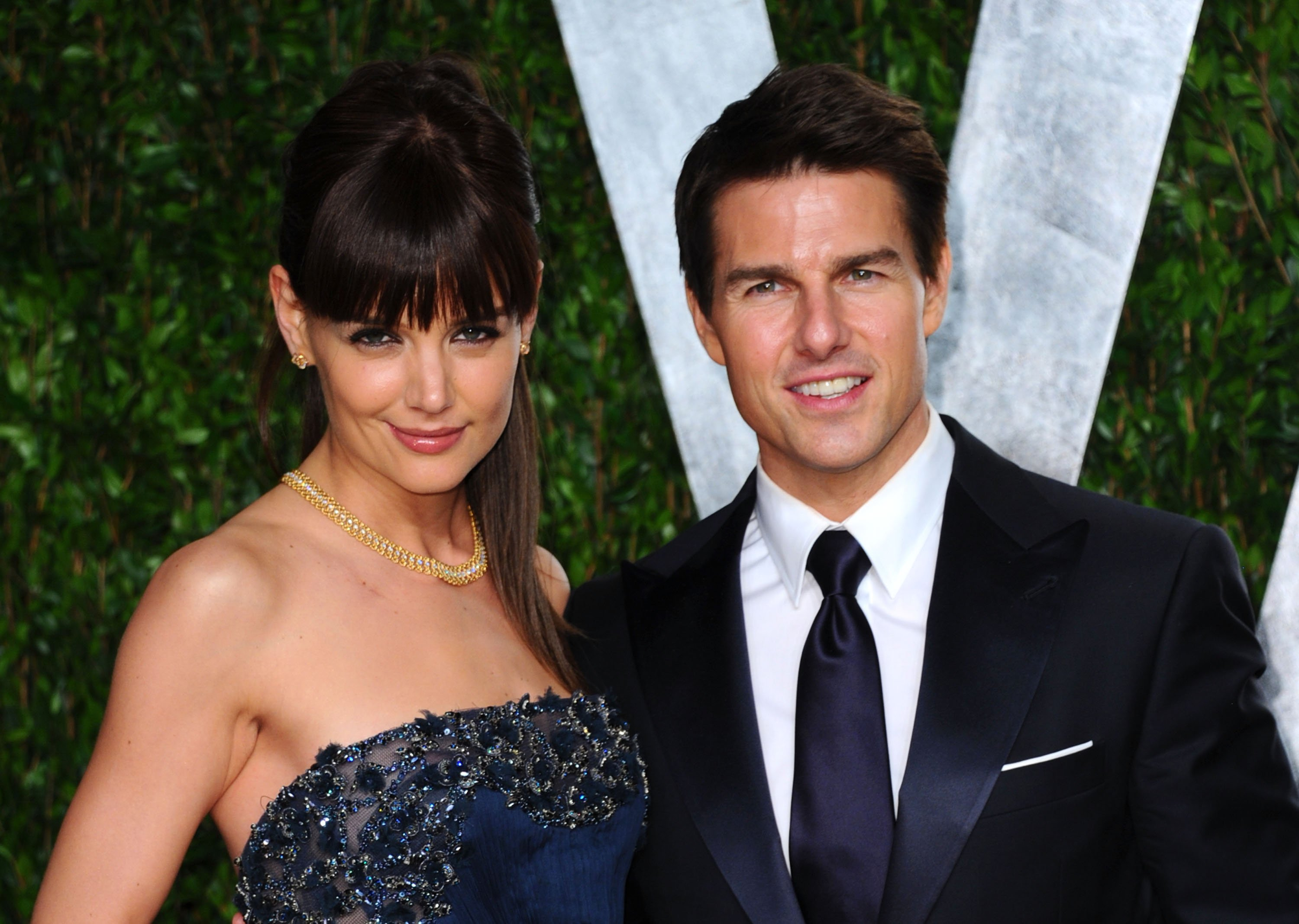 Actress Katie Holmes (L) and actor Tom Cruise arrives at the 2012 Vanity Fair Oscar Party on February 26, 2012, in West Hollywood, California. | Source: Getty Images.