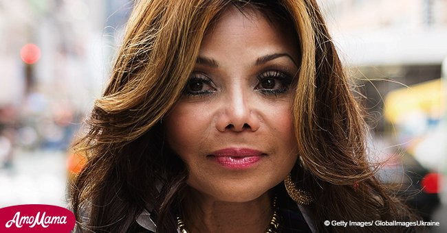 La Toya Jackson Puts On A Very Busty Display In A Plunging Black Leather Gown