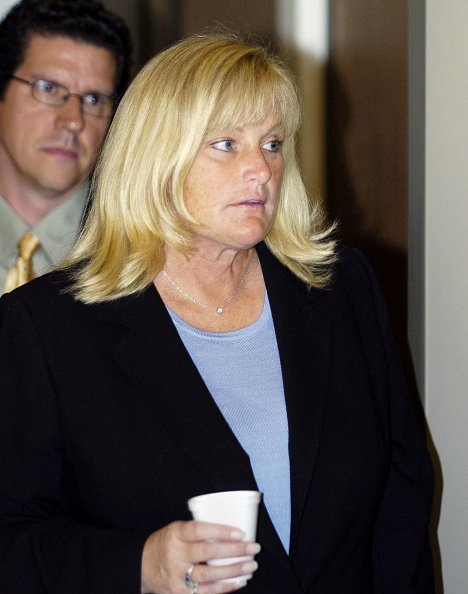 Debbie Rowe, Michael Jackson's ex-wife and mother of two of his children, steps from the courtroom during Jackson's child molestation trial at the Santa Barbara County courthouse April 28, 2005, in Santa Maria, California. | Source: Getty Images.