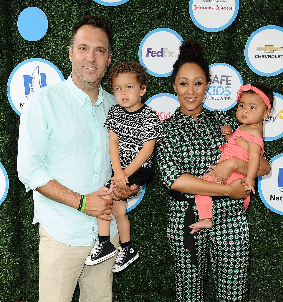 Adam Housley, Aden Housley, Tamera Mowry and Ariah Housley arrive at the Safe Kids Day event on April 24, 2016, in Culver City, California | Source: Getty Images (Photo by Jason LaVeris/FilmMagic)