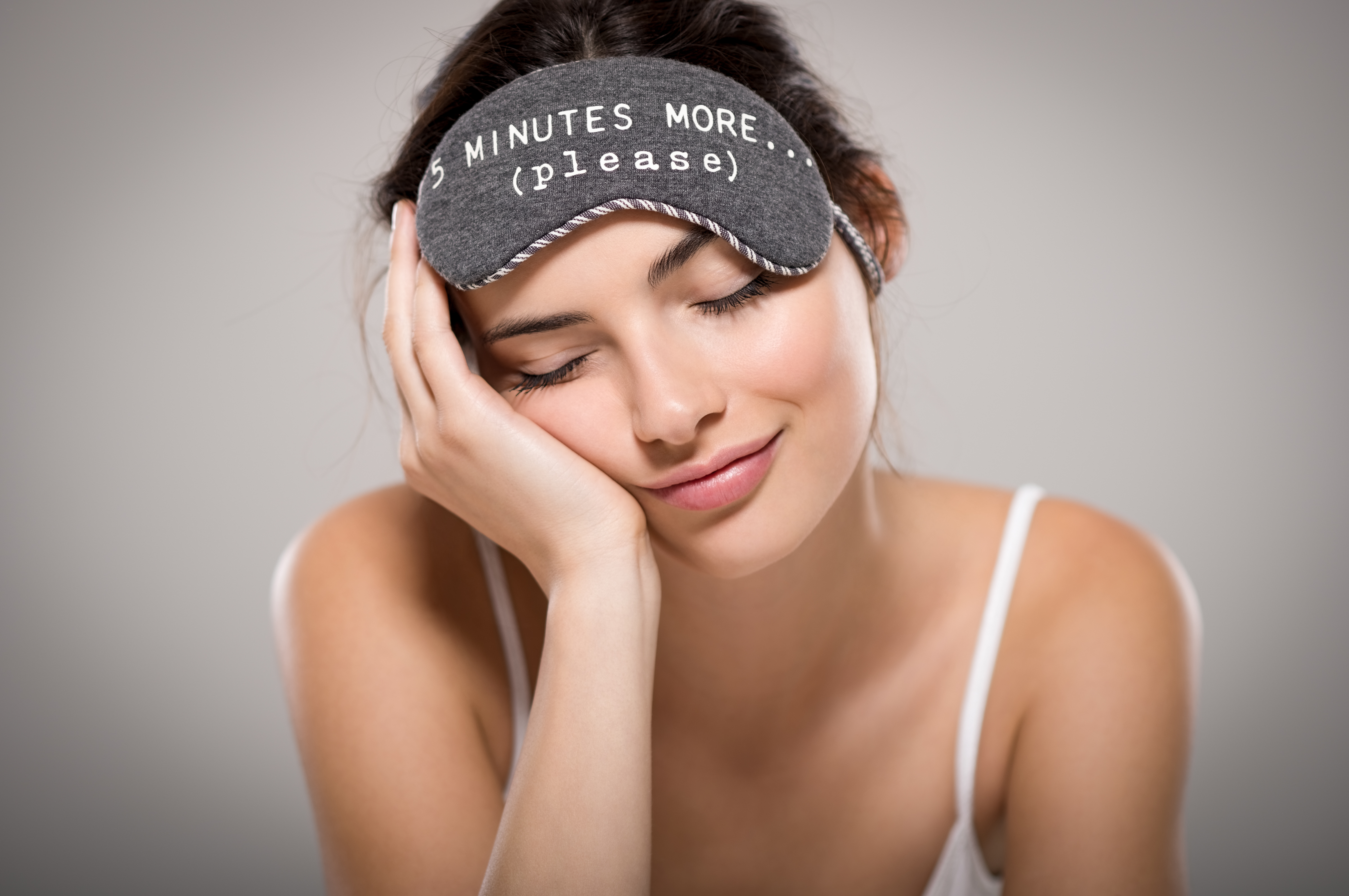 Young beautiful woman sleeping with eye mask | Photo: Shutterstock.com