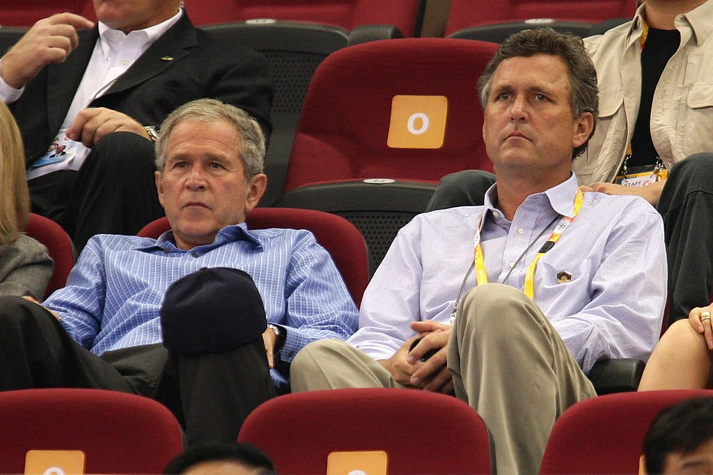George W. Bush and brother Marvin Bush watch the women's preliminary basketball game between the United States and Czech Republic on August 9, 2008. | Photo: Getty Images