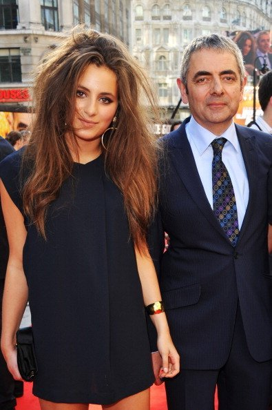 "Lily Atkinson and actor Rowan Atkinson attend the ""Johnny English Reborn"" UK premiere 