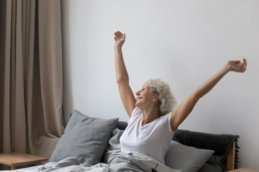Refreshed middle aged senior woman sitting in bed   Source: Shutterstock