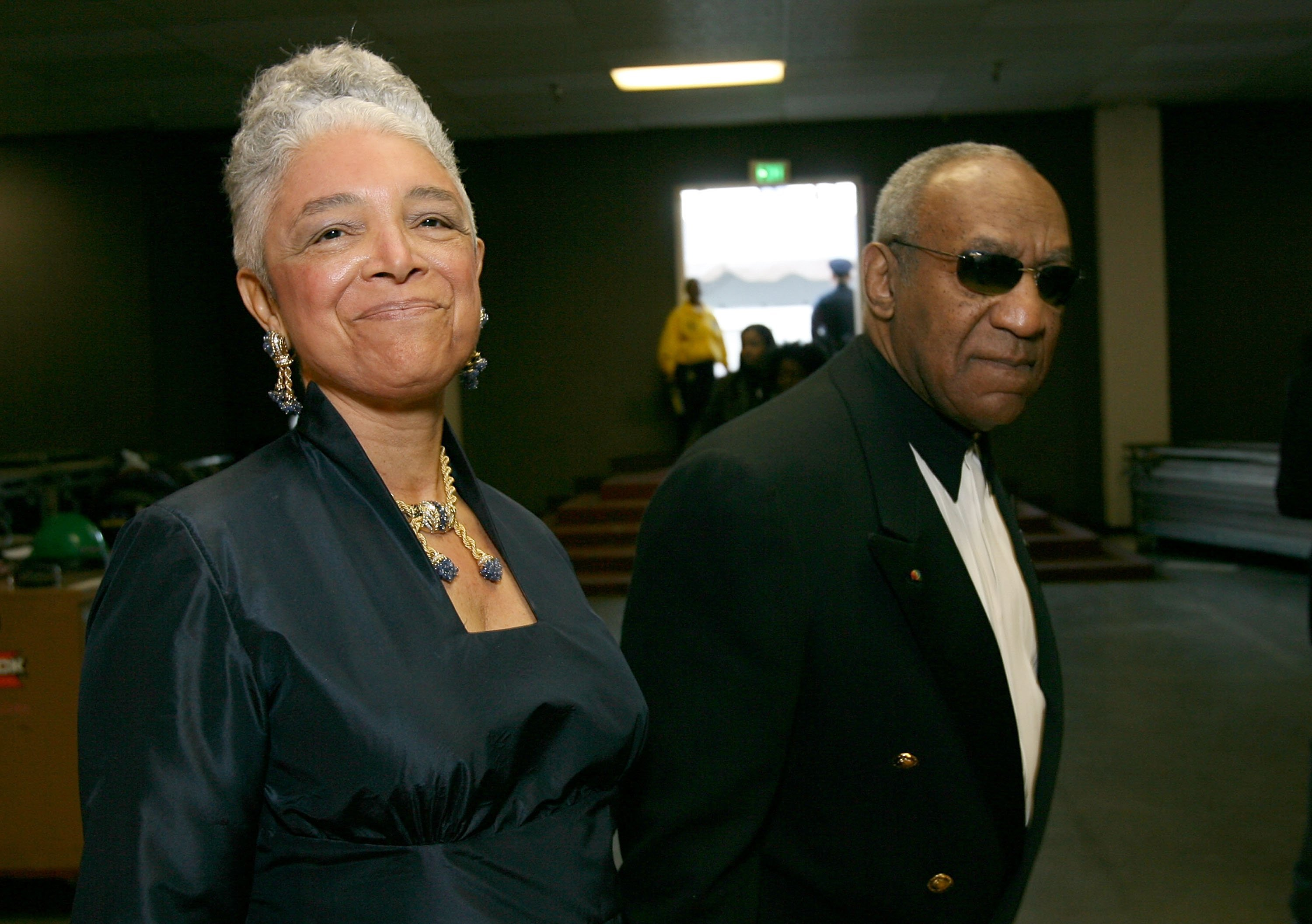 Comedian Bill Cosby and wife Camille O. Cosby walk backstage during the 38th annual NAACP Image Awards held at the Shrine Auditorium on March 2, 2007, in Los Angeles, California. | Source: Getty Images.
