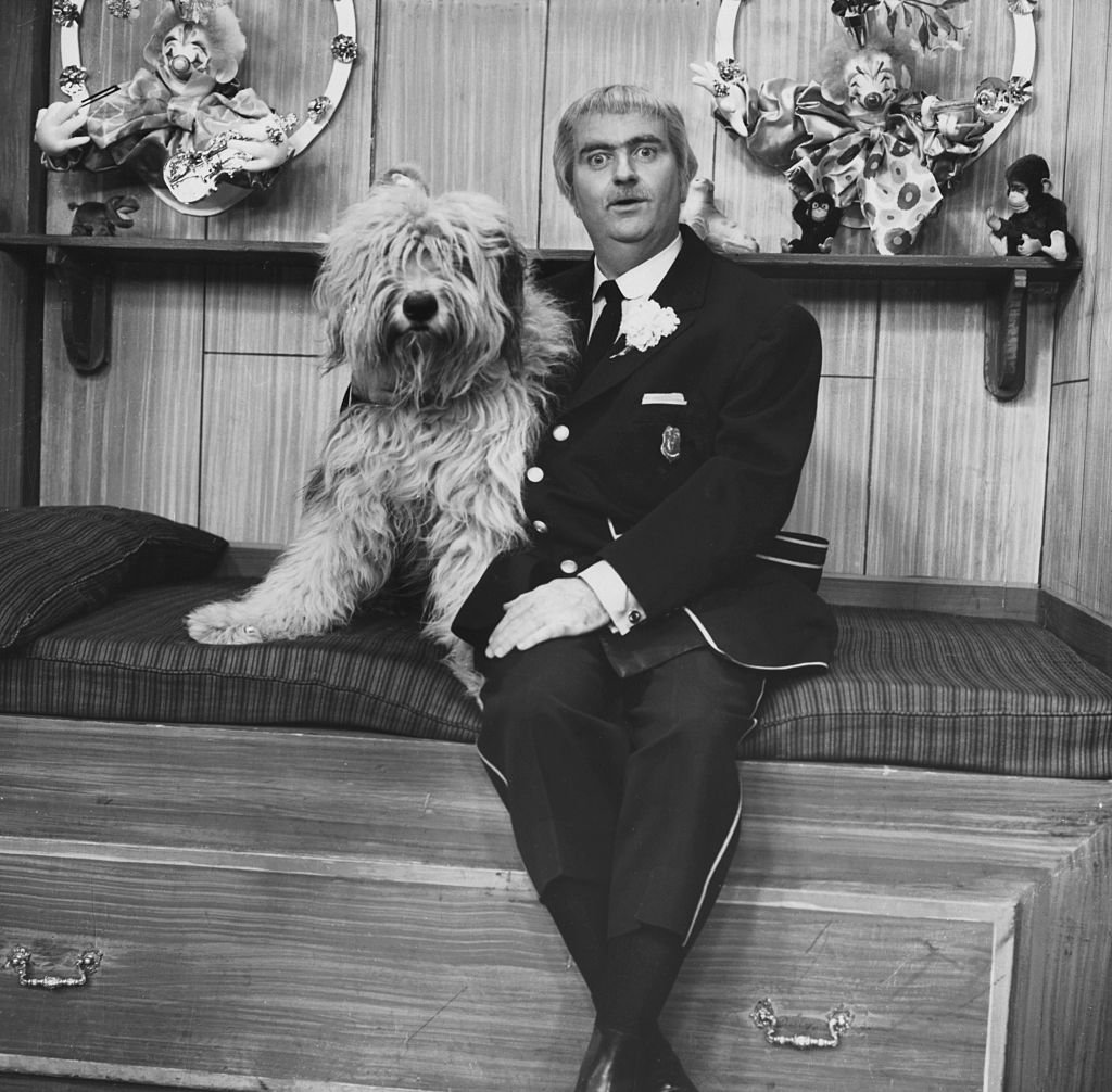 """Television still featuring Bob Keeshan with a dog on the popular kid's show, """"Captain Kangaroo 