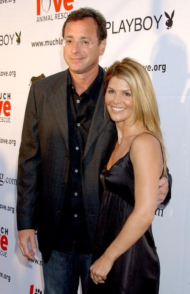 """Bob Saget and actress Lori Loughlin arrive at the """"Much Love Animal Rescue Benefit"""" at the Playboy Mansion in Los Angeles, California 