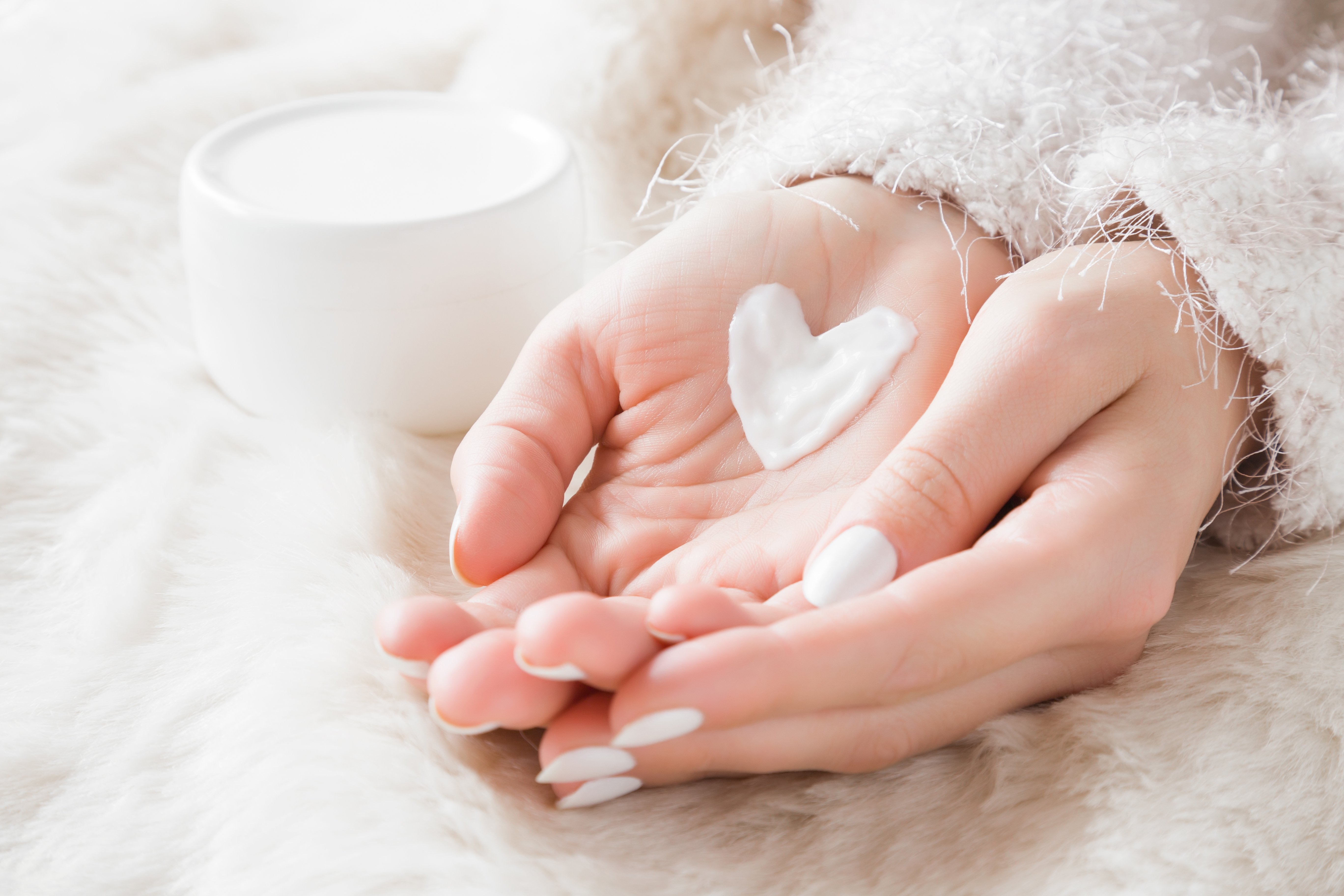 Hands filled with lotion heart | Shutterstock